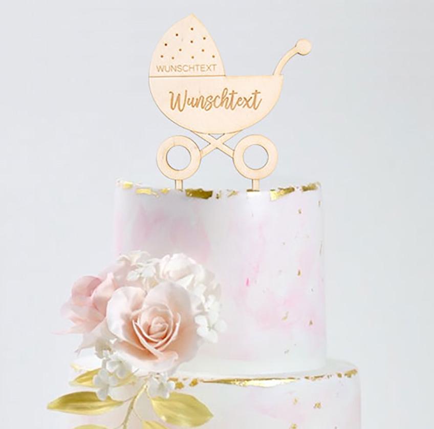 Motto-Taufe mit Baby-Motiven - dazu passt auch der individuelle Cake-Topper